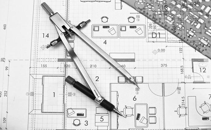 Bauplan mit Zirkel und Bleistift