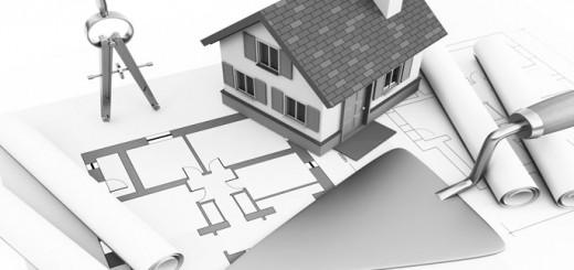 Miniaturhaus auf Bauplan